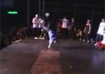 Boy Breakdances off Stage